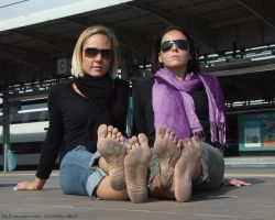 Alyssa and Aiko: a barefoot wait for the train by Feetosopher