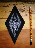 Skyrim dragon embroidery by sleepyhamsteri