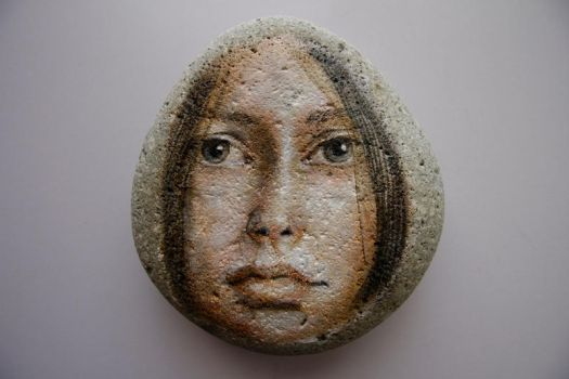 Girl painting on stone by LosOjosNegros