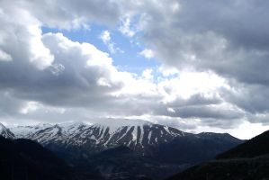 Grey over mountains by hellenicwarrior