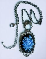 Blue rose necklace by Pinkabsinthe