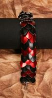 Red and black scale bracelet by DracoLoricatus