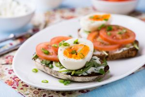 Rye toast with egg, tomato and soft cheese by BeKaphoto