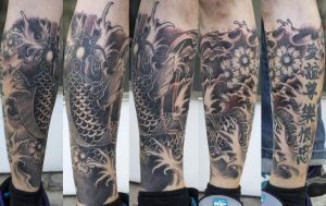 black koi karp on leg by graynd