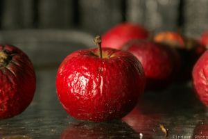 Apple on a table by Findsen