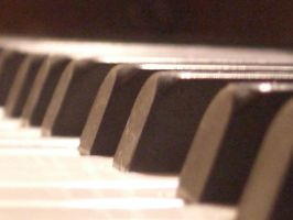 Piano keys close up by barefootliam