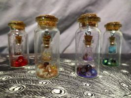 A Bottle Within a Bottle Charms by ADarkenedHollowLight