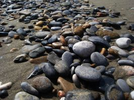 stones on the beach by areeen