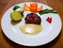 Steak with cream sauce and potatoes by yvsan