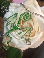 Green Dragon Resting on a White Rose by WireMoonJewelry