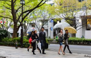 Two umbrellas on Omotesando by Rikitza