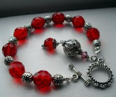 silver and red glass bracelet by merpagigglesnort