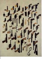 Don Daggett's carvings of guns by xypetotec