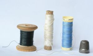 sewing threads and a thimble by doko-stock