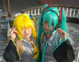 miku hatsune and akita neru by Electric-Cat