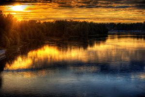 Sunset over the river by Quipith