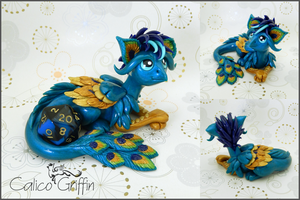 Crissi the peacock griffin - polymer clay by CalicoGriffin