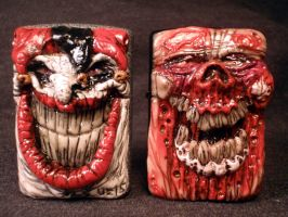 Evil Jester and jaw Rot Zombie Zippos by Undead-Art