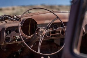 Rusty old car in the desert by RusherVision