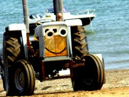 Tractor on the beach. by PhotographyisArt123