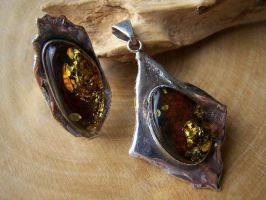 Amber ring and pendant by MadOnion1