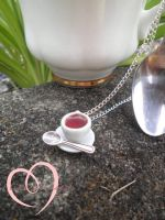 Teeny Teacup necklace by ilikeshiniesfakery