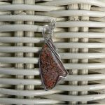 Light Red and Grey Dinosaur Bone in Silver by magpie-poet