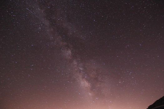 Milky Way and a shooting star at Red Rock, CA by persomatey