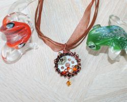 Orange steampunk bottle cap necklace by SuperFlashDance