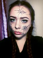 Cracked doll by YourDementedAlice
