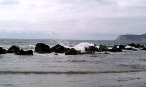 waves crashing against the rocks by capturedpoetry