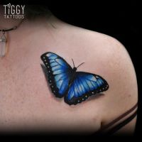 Blue butterfly by tiggytattoos