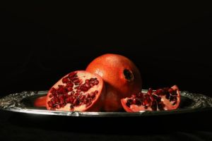Pomegranates on a Silver Platter by Adonenniel