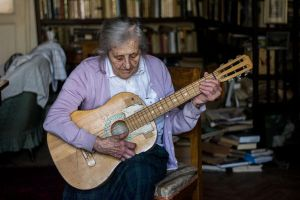 Mima playing on guitar by esztervaly