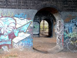 bridge arches with graffiti by stupidstock