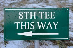 8th tee this way sign on a links golf course by morrbyte