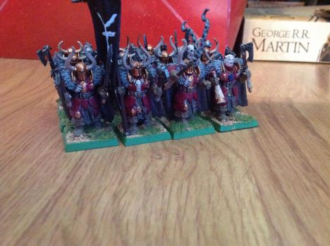 The bronze helms in all their evil glory by Melkor13