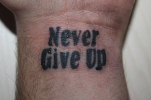 never give up tattoo by sasan-ghods