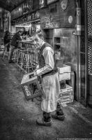 Barman at work by Fogherty