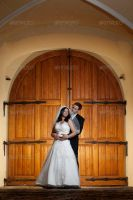 Bride and Groom at the Manor Gate by Ondrejvasak