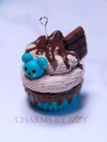 Chocolate blue cupcake with and chocolate bar by CharmsByIzzy