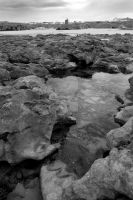 rock formations with castle in black and white by morrbyte