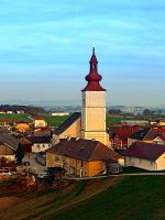 Village and church in warm sundown light by patrickjobst