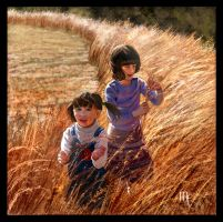 Girls playing in the wheat field by turkill