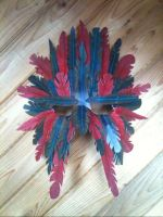 Red and blue feather mask by chrisjamesart