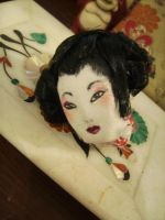 geisha doll head by curlytopsan