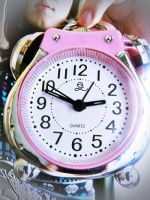 pink clock. by Freaks2