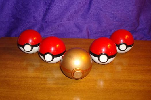 The golden pokeball by NuclearBombFlower