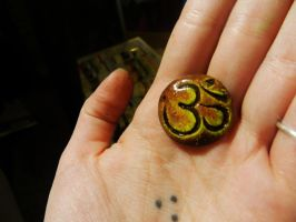 Golden Om Pendant by PoisonJARCreations