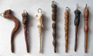 Harry Potter pendants: wand set by EerieStir